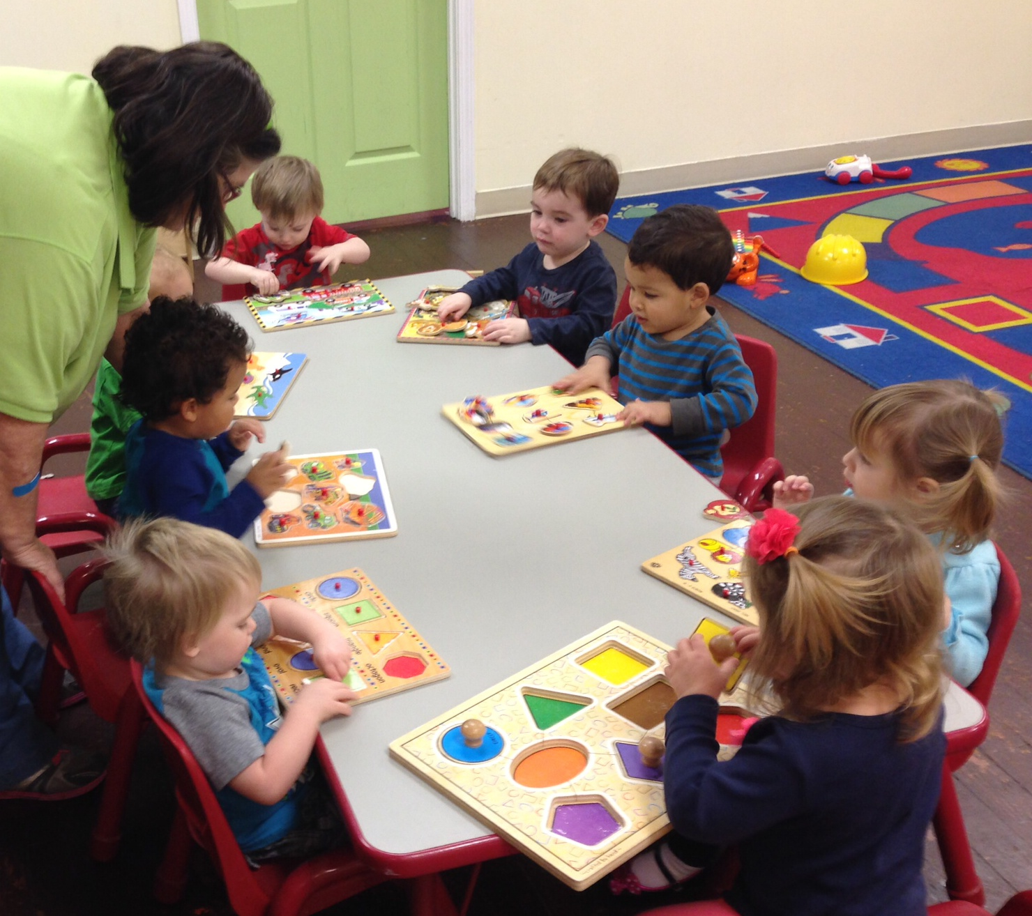 Pre-k 2 kids playing with puzzles